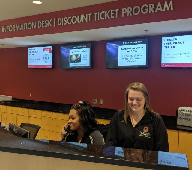 Student employees working at the Information Center in the Ohio Union.