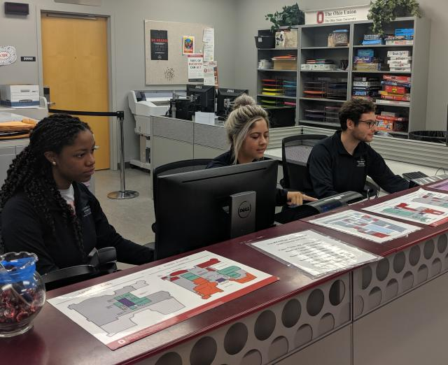 Student employees working at the Resource Room front desk.